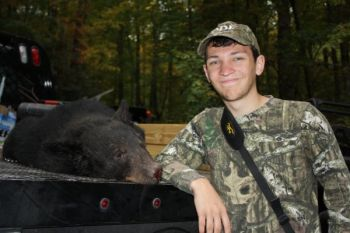 Riley Harrison of Woodruff took his first bear while hunting with the Mike Morgan Hunt Party in connection with the Outdoor Dream Foundation near Laurel Fork Creek.