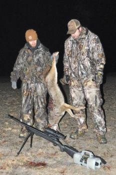 John Alden and Jesse Cadenhead took this coyote with the help of an electronic caller and a night-vision scope.