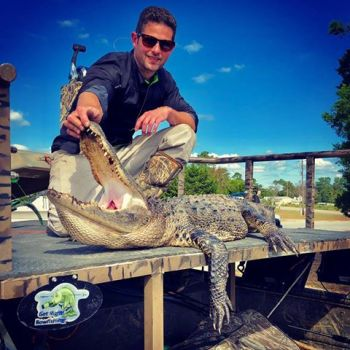 Ryan Pridgen of Raleigh poses with the gator he killed during North Carolina's 2018 alligator hunting season.