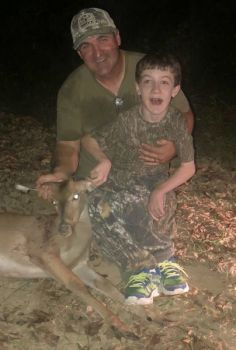 Dad Dana Sanders and son Jason with the youngster's spike buck taken with a crossbow on Oct. 8.